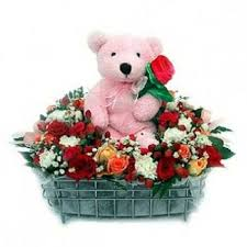 basket arrangement of 50 mix colour roses with teddy bear