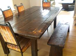 rustic wood dining room table with full set of chairs extra bench
