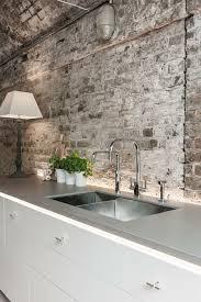 modern bricks countertop and white brick backsplash