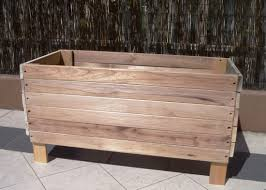 large old reusable and reclaimed raised wood planter boxes with
