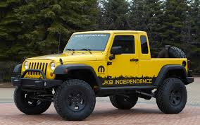 2011 jeep wrangler unlimited price 2011 jeep wrangler unlimited jk8 front three quarter mudder