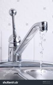 Leaky Faucet Kitchen Water Dribbling Leaking Faucet On Kitchen Stock Photo 39457027