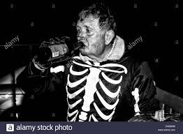 man in halloween skeleton costume drinking beer from a bottle