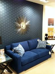 blue living room bohedesign com dark chairs and with accent wall