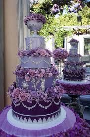 fancy wedding cakes fancy purple wedding cake with purple flowers arabia weddings