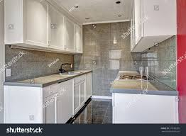 wall tiles for white kitchen cabinets white kitchen cabinets grey tile wall stock photo edit now