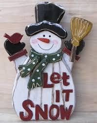 wooden snowman the aisle wooden snowman let it snow oversized figurine