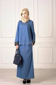 beautiful clothes photo of a beautiful woman in the modern muslim clothes with bag