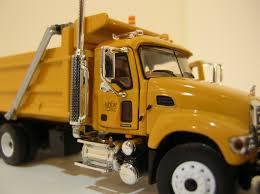 mack dump truck mack granite dump truck with plow 1 64 scale first gear toyhabit
