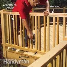 how to build a cedar deck railing with glass family handyman