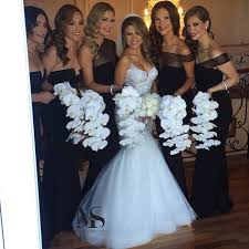 black and white wedding bridesmaid dresses black bridesmaid dresses with white orchid bouquets black and