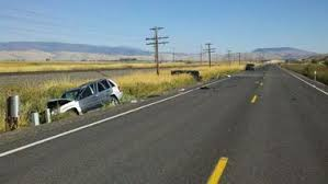 oregon state police investigating car crash on highway 203 east of