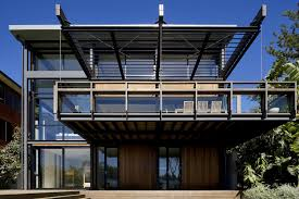 use of steel glass and recycled timbers creates a modern home