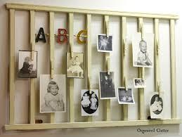 organized clutter re purposed crib rail photo display