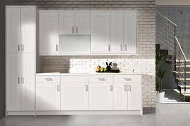concrete countertops white shaker kitchen cabinets lighting