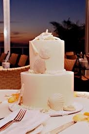 beach theme wedding cakes with white seashells the wedding