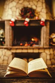 open book by the fireplace with ornaments open storyb