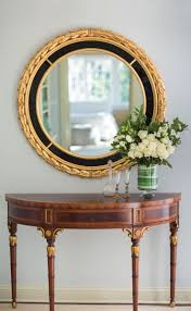 round mirror and italian neoclassic style mirror