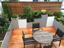 Rooftop Patio Design Exterior Small Kings Cross Roof Rerrace With Round Wooden Table