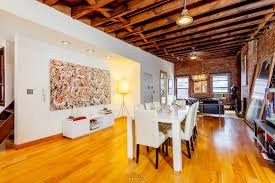 Kitchen Interiors A 32 Foot Long Living Room With Exposed Brick Dominates This