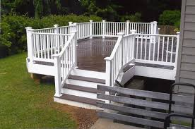 exterior design saddlebrown azek decking and white railing plus