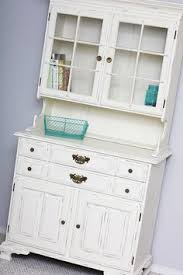a beautiful kitchen hutch finished in old white chalk paint