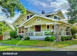 green old craftsman style home covered stock photo 89441392