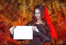 beautiful angry halloween witch with long hair holding sheet