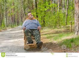 Blue Wicker Rocking Chair Man Is Having Rest In Forest Sitting On A Wicker Rocking Chair