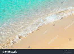 beautiful transparent seashore sea foam italian stock photo