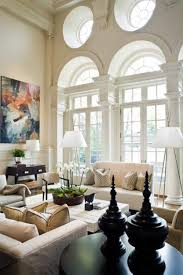 living room decorating a large wall with high ceiling for using