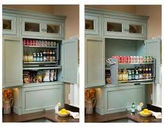 Kitchen Cabinet Shelves by Our Two Tiered Pull Down Cabinet Shelf Brings Items In Wall