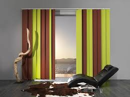 green vertical blinds for a living room with green furniture