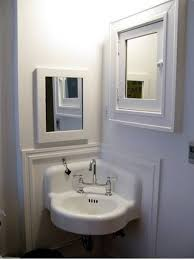 corner bathroom sink with mirror and recessed medicine cabinet