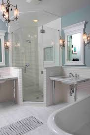 bathroom corner shower stalls with tile flooring and marble