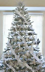 christmas tree with snow silver and white christmas tree