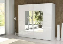 innovative wardrobe design with sliding doors and mirror also