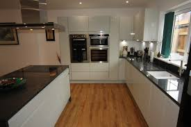 grey kitchen cupboards with black worktop white gloss kitchen with black granite worktops worcester