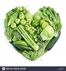 types of green color heart shape form by various type of vegetables and fruits in green