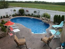 Modern Backyard Ideas by Orange Umbrella With Soft Blue Chaise Lounge And Enticing Swimming