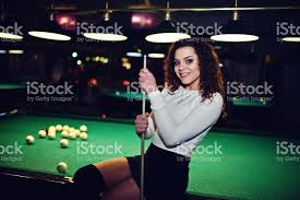 adult mini games young curly girl posed near billiard table sexy model at black mini
