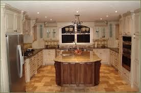 antique white kitchen cabinets with dark floors