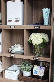 a kitchen storage and display bookcase setting for four