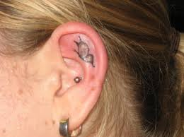 small ear something like this but my birthstone