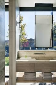 floating mirror in front of a window bathroom by meyer davis
