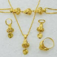 gold necklace bracelet earrings set images Arabic gold jewelry 22k heart jewelry set necklace pendant jpg