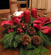 ideas for christmas centerpieces by red candles with brown pines