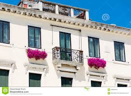 luxury white hotel exterior with flowers decoration stock photo
