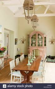 old french farmhouse table in dining room with swedish style