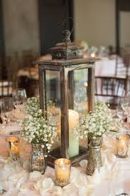 rustic wedding picture of a rustic lantern of wood candles around and vintage